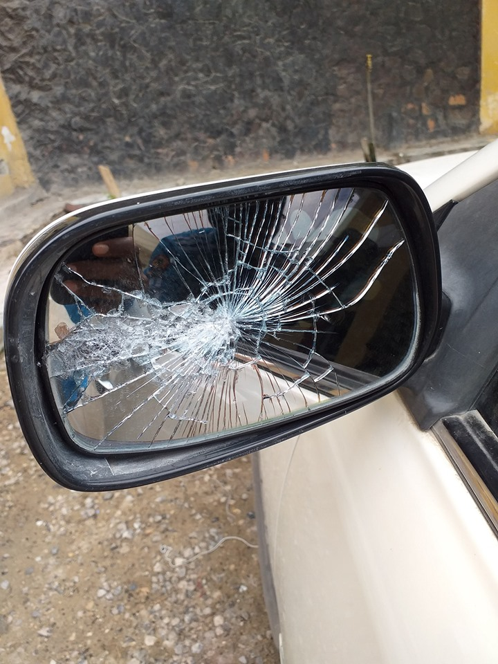 Photo shows the smashed sidebar mirror of the journalist's car. | Photo courtesy/Facebook Hussein Abdulle Mohamed.