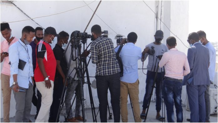 Journalists cover a press conference by SJS secretary general in Mogadishu on Monday 22 March, 2021.   PHOTO by Mohamed Jibril for SJS.